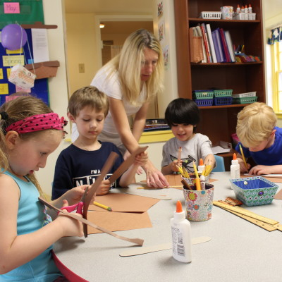 The Kindergarten class exercises their writing and spelling skills in creating unique invitations to our end of year picnic.