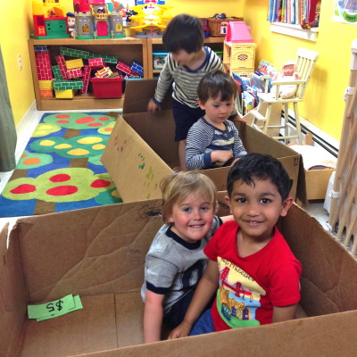 Our youngest kids explore the endless creative possibilities of a cardboard box.